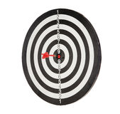 Red dart punctured in the center. Of the target stock photos
