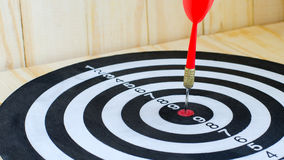 Red dart stab on target classic board Royalty Free Stock Photo