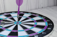 Red dart stab on target classic board Stock Image
