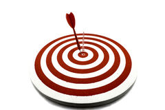 Red dart target. With red arrow Stock Images