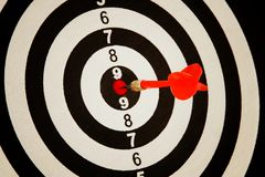 Red darts arrow in the target center. Royalty Free Stock Image