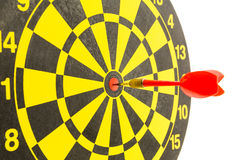 Red darts in bullseye of dartboard Stock Images
