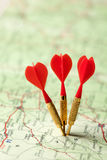 Red darts in a road map Royalty Free Stock Image