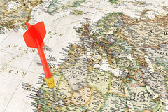 Red darts on world map Stock Image