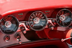 Red Dash. This is a dashboard from the inside of a classic car showing the gauges Royalty Free Stock Photo