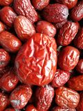 Red Date - Jujube Fruit Big Small. Closeup to a big Red Date - Jujube Fruit - /Fructus Jujubae among some small ones. They are different types. Ziziphus jujuba Stock Images