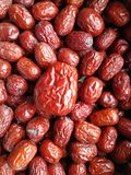 Red Date - Jujube Fruit Big Small. Closeup to a big Red Date - Jujube Fruit - /Fructus Jujubae among some small ones. They are different types. Ziziphus jujuba Royalty Free Stock Images