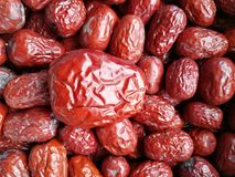 Red Date - Jujube Fruit Big Small. Closeup to a big Red Date - Jujube Fruit - /Fructus Jujubae among some small ones. They are different types. Ziziphus jujuba royalty free stock photography