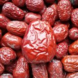 Red Date - Jujube Fruit Big Small. Closeup to a big Red Date - Jujube Fruit - /Fructus Jujubae among some small ones. They are different types. Ziziphus jujuba stock photography