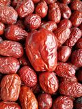 Red Date - Jujube Fruit Big Small. Closeup to a big Red Date - Jujube Fruit - /Fructus Jujubae among some small ones. They are different types. Ziziphus jujuba stock photo