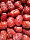 Red Date - Jujube Fruit. Closeup to a big Red Date - Jujube Fruit - /Fructus Jujubae among some small ones. They are different types. Ziziphus jujuba,commonly royalty free stock photo