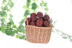 Red dates. In the basket, white background Stock Photos