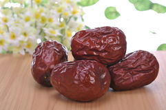Red dates. In flowers and plants background Stock Photos