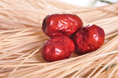 Red dates. Four red dates are arranged in order of the basket Royalty Free Stock Image