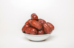 Red dates. White background, indoor shooting dates royalty free stock photos