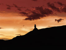 A Red Dawn. With a rock silhouette in front Royalty Free Stock Photo