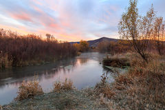 Red dawn morning by a flowing stream in the rural Utah mountains. Royalty Free Stock Image