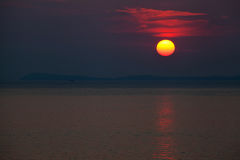 Red dawn over blue sea Royalty Free Stock Photography