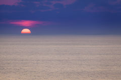 Red dawn over blue see Royalty Free Stock Image