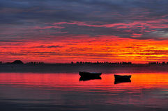 Red Dawn over The Lagoon. Awe inspiring dawn over the Mar Menor lagoon on Spain's Costa Calida. The extraordinary light makes this image look like a fine art Royalty Free Stock Photography
