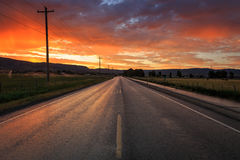 Red dawn road and field landscape in the Wasatch Mountains, Utah. Royalty Free Stock Photos