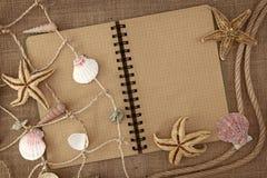 Red de pesca y libro de ejercicio Imagen de archivo libre de regalías