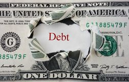 Red debt. Hole torn in a dollar bill with Debt in red Stock Photos