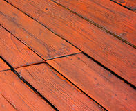 Red deck boards. Closeup of red deck boards on angle Stock Images