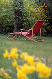 Red deck chair Stock Images