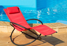 Red deck-chair on the wooden floor Royalty Free Stock Photo