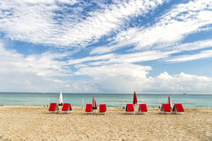 Red deck chairs in South beach Stock Image