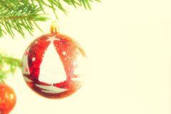 Red decorated ball in Christmas tree Stock Photo
