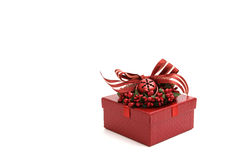 Red decorated christmas gift box isolated on white Royalty Free Stock Photography
