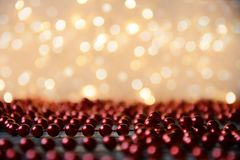 Red decorating pearls with lights blur effect Stock Photography