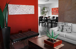 Red decoration. Livinig and dinning room with red walls and trendy decoration Royalty Free Stock Photo
