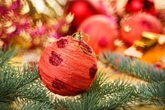 Red decoration ball with spruce branch Stock Photography