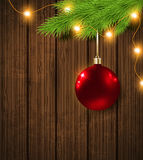 Red decoration and garland. Shining red decoration, green fir branch and garland. Christmas background Royalty Free Stock Photo
