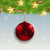 Red decoration and green fir branch Stock Photo