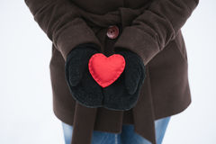 Red decorative heart in the hands Royalty Free Stock Image