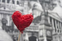 Red decorative heart on a stick on a gray background. Stock Image