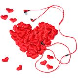 Red decorative hearts in the shape of a big heart, earphones fro. Red decorative hearts in the shape of a big heart, headphones from the heart, the concept royalty free stock photos