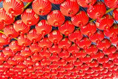 Red decorative lanterns hang on the ceiling. royalty free stock images