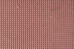 Red decorative tile  closeup Royalty Free Stock Photo
