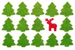 Red deer among fir-trees. Christmas postcard with red felt deer among green felt fir-trees Stock Photos