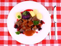 Red deer goulash with potato, Burgundy sauce and wild berries Royalty Free Stock Photography