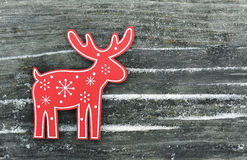 Red deer with snowflakes and snowdrifts Royalty Free Stock Image
