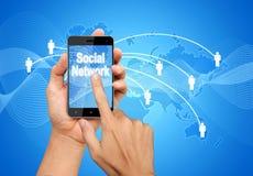 Red del Social de la pantalla del teléfono del presionado a mano Imagen de archivo libre de regalías