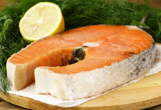 Red delicatessen  fish  salmon with lemon Stock Photos