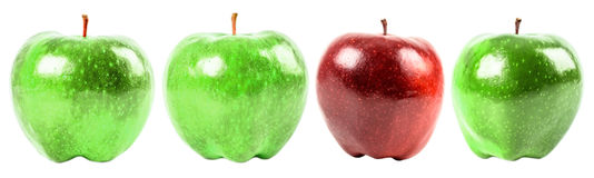 Red Delicious Apple Among Green Apples Royalty Free Stock Photos