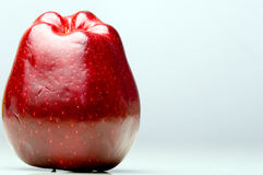 Red delicious apple on the left side. Red delicious fresh apple on the left side royalty free stock image